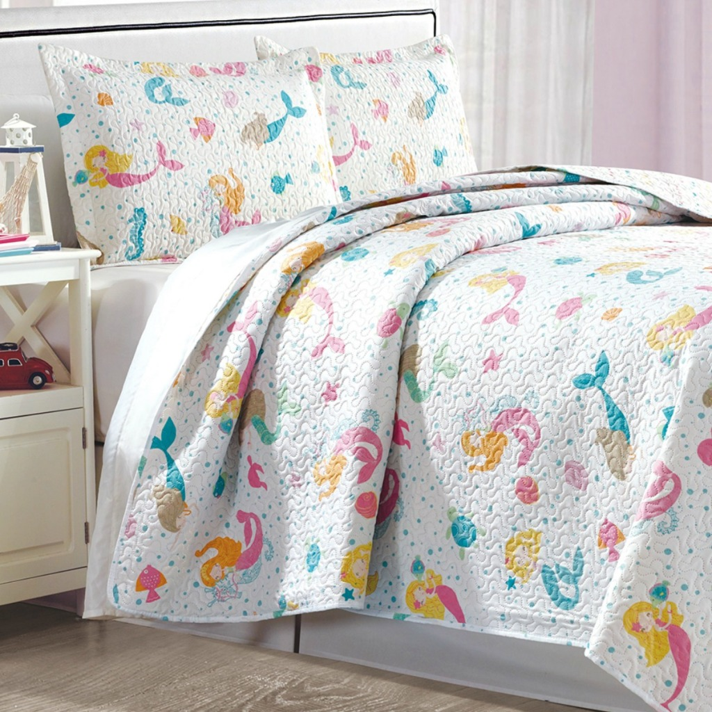 Mermaid print quilt from Zulily on a full size bed