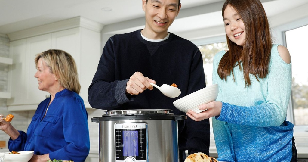 family around instant pot ultra eating dinner