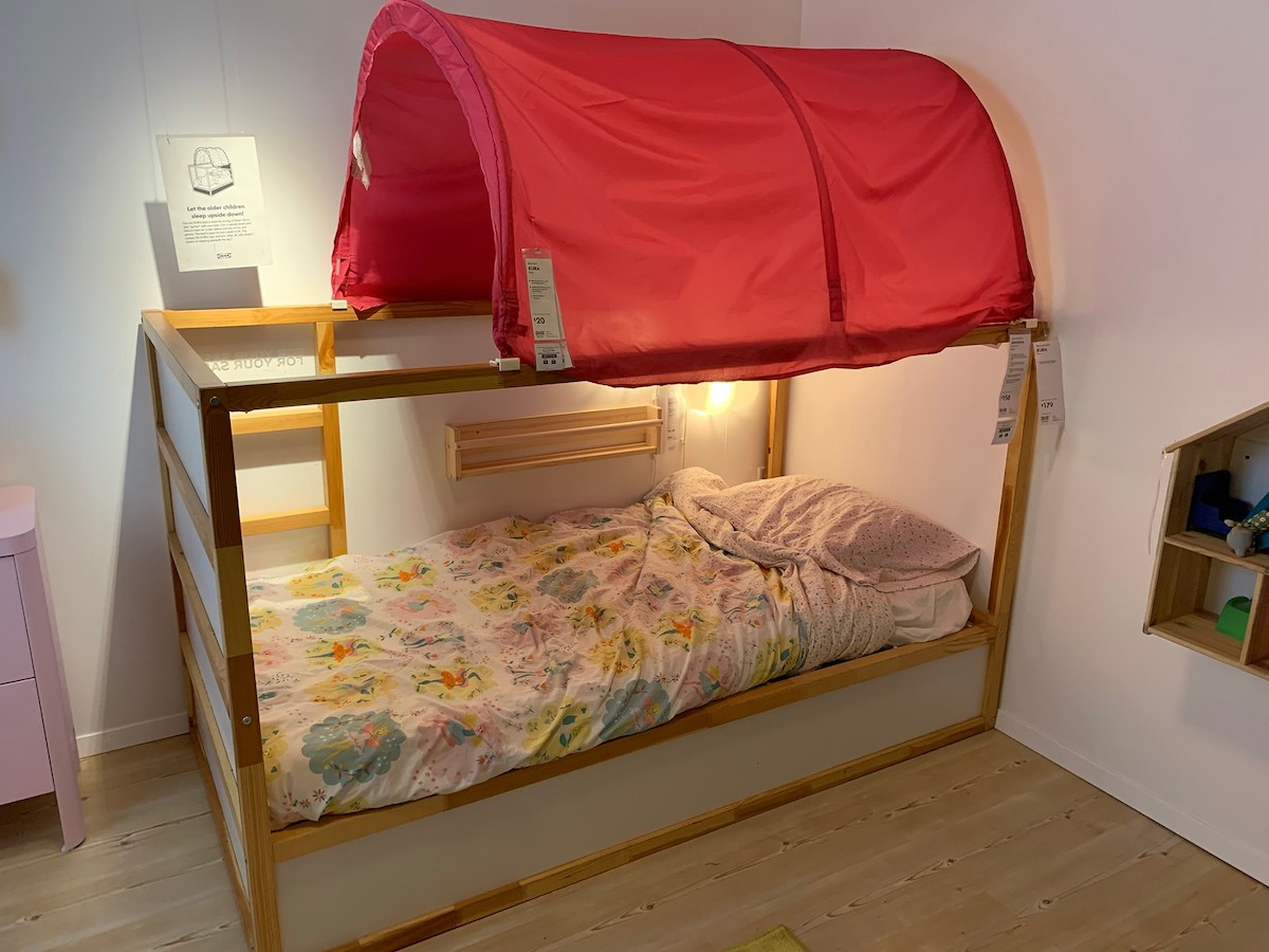 KURA reversible bed with red tent canopy and lights