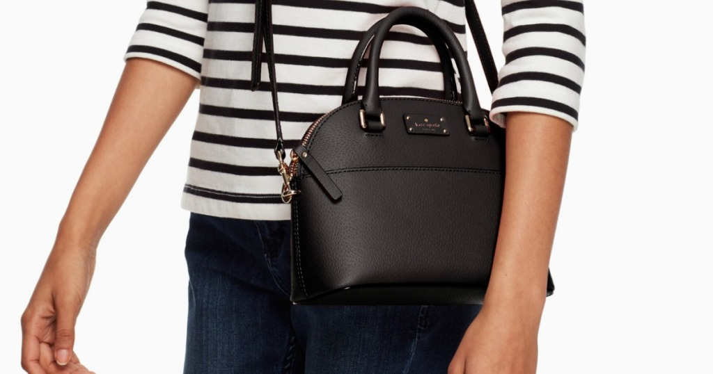 Woman wearing Kate spade brand satchel in black