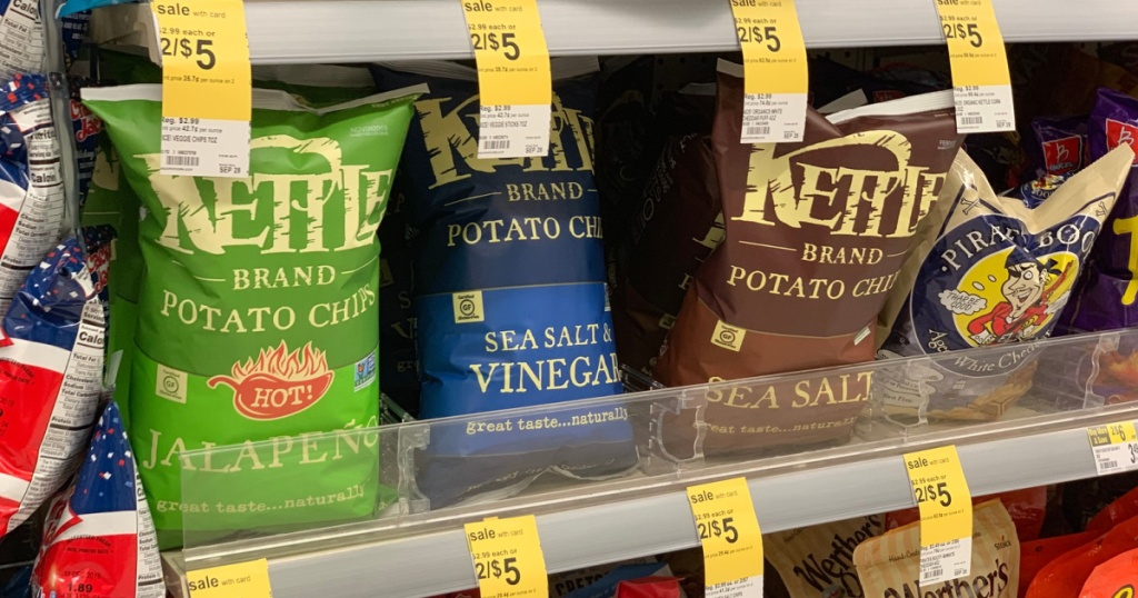 kettle brand bags of chips on shelf at store
