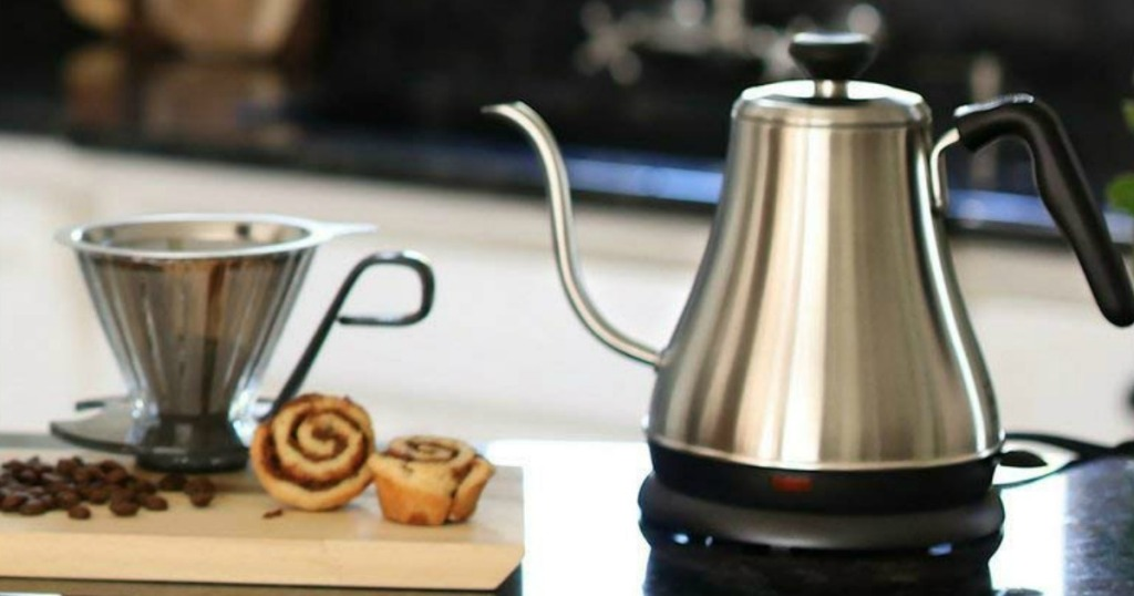 KETTLE next to a cinnamon roll