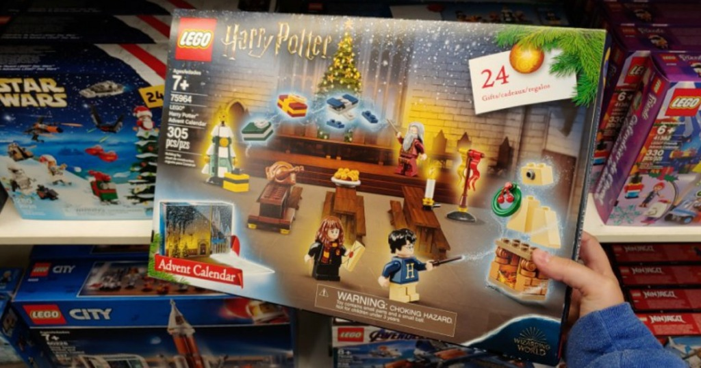 person holding the LEGO Harry Potter Advent Calendar 2019