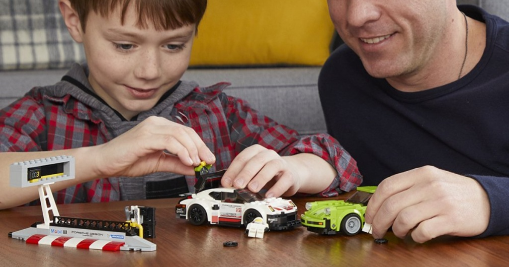 kid and dad playing with lego speed champions porche lego set
