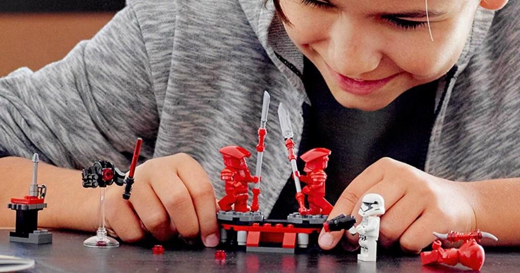 boy playing with LEGO Star Wars Elite Praetorian Guard Battle Pack