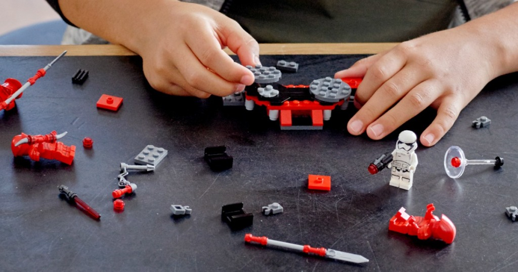child's hands playing with LEGO Star Wars Praetorian Guard Battle Pack