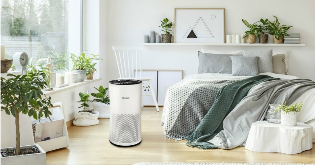 LEVOIT Tower Air Purifier on floor of bedroom