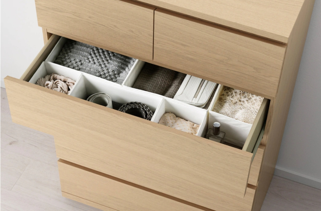 natural wood dresser with organizers and clothes in drawer IKEA
