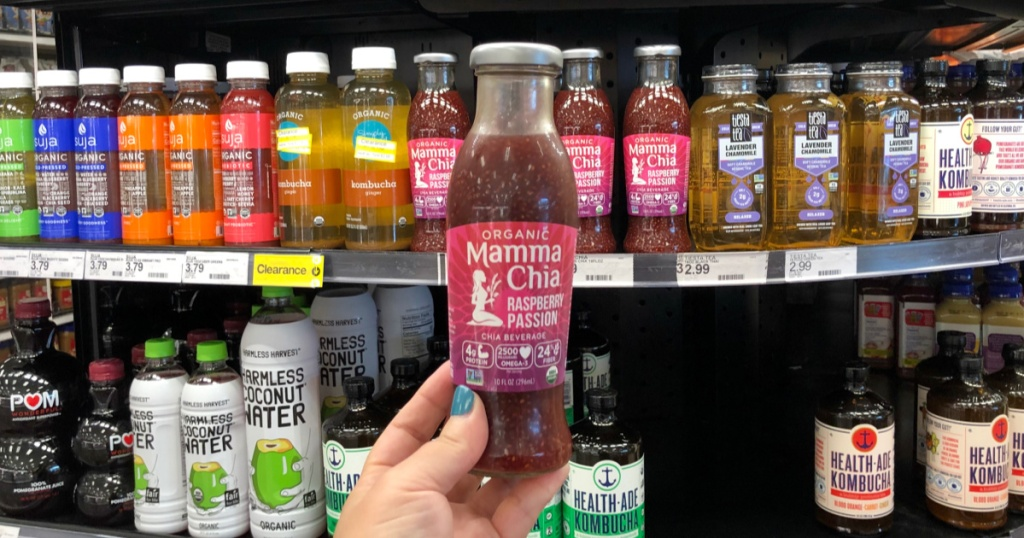 hand holding up bottle of mamma chia beverage at target