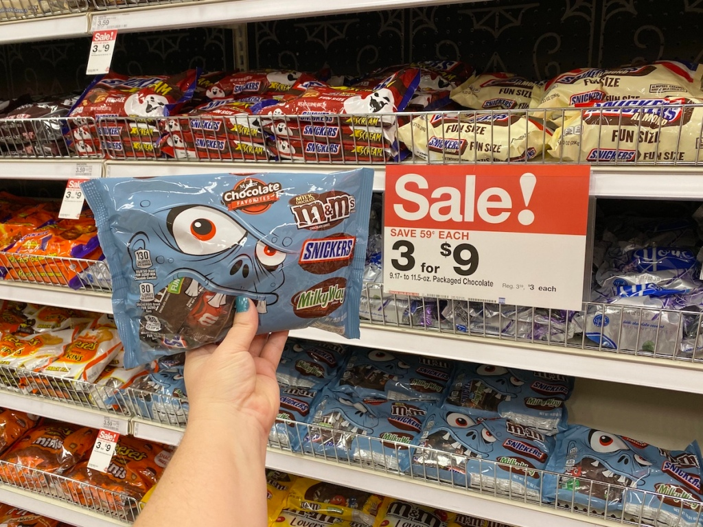 hand holding Mars Variety Pack of candy at Target