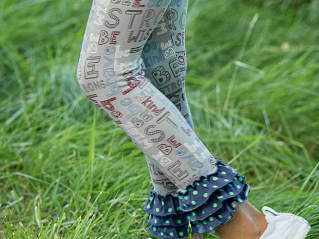 Matilda Jane Grey and Blue Ruffle Hem Wise Words Leggings on grass