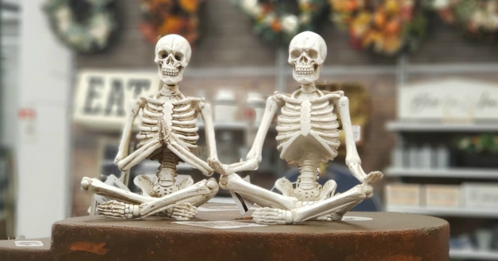 Yoga posed Skeletons on counter at Michaels