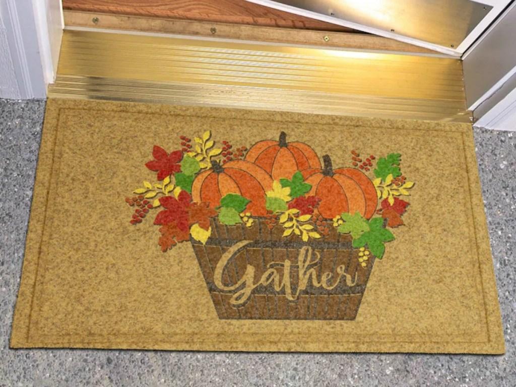 Mohawk Home Pumpkin Basket Welcome Mat in doorway