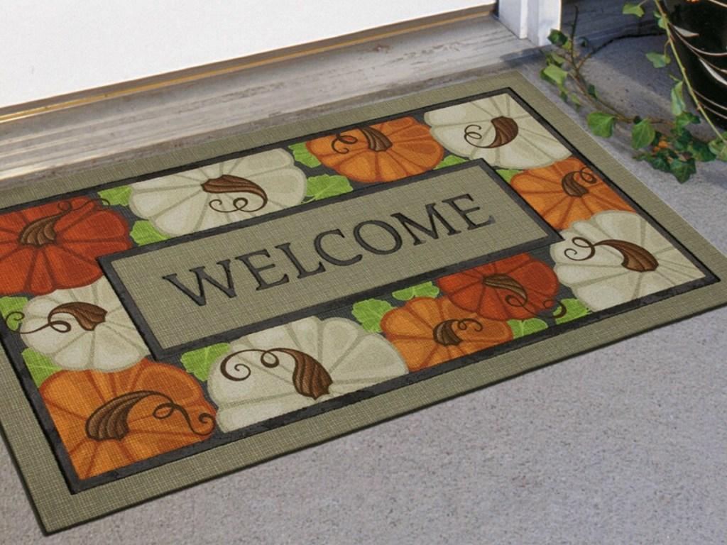 Pumpkin bordered welcome mat