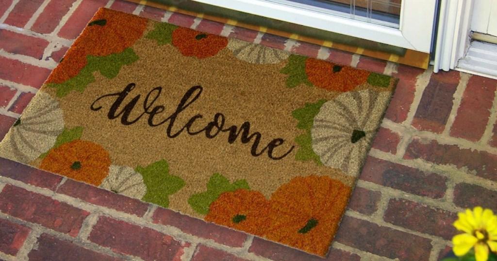 Welcome Fall Themed Doormat on brick doorway