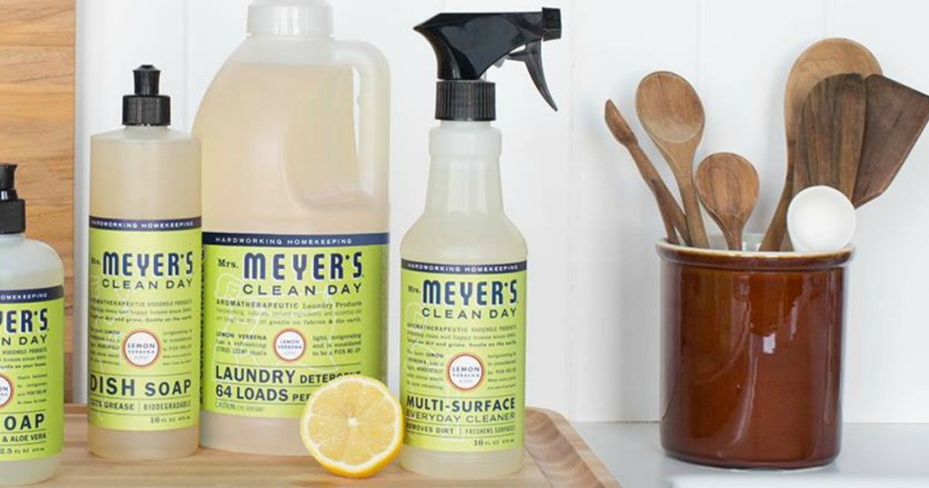 Line of Mrs. Meyer's brand cleaning supplies in kitchen