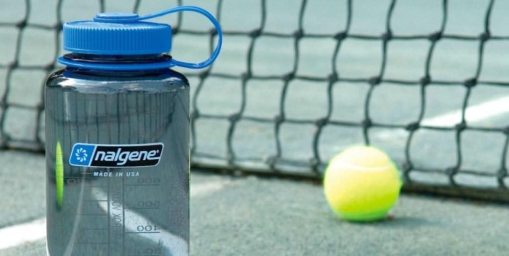 Blue Water Bottle from Nalgene in tennis court