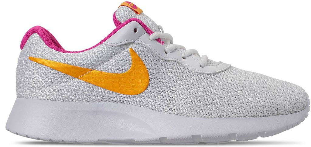 white nike shoes with a yellow/orange swoosh and pink inner