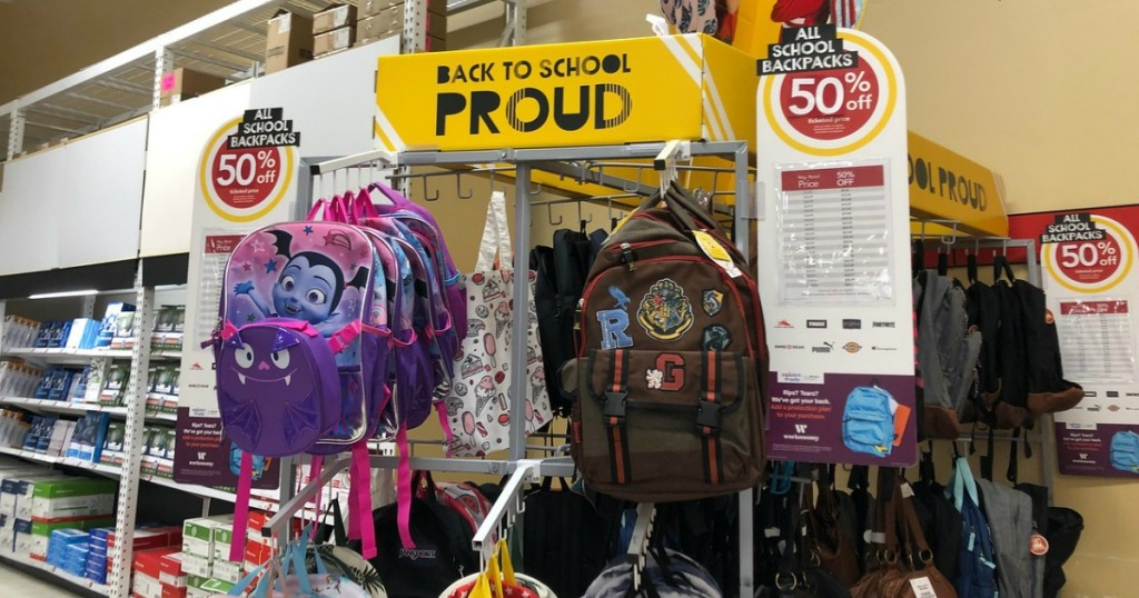 backpacks hanging on a display at Office Depot
