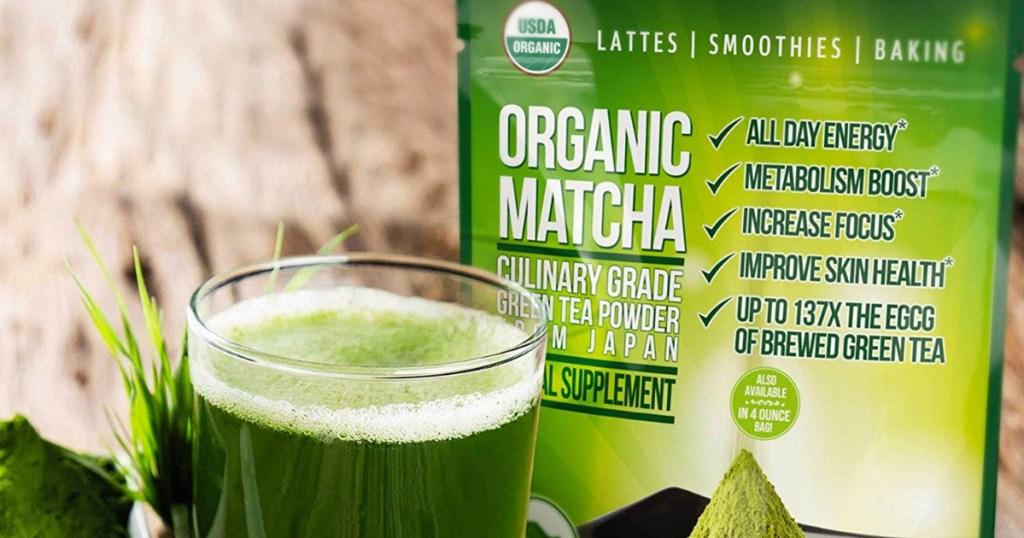 Glass of Green Matcha Tea near a bag of Matcha Tea Powder