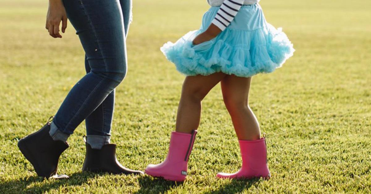 girl wearing pink Totes Cirrus Charley Kids Rain Boots