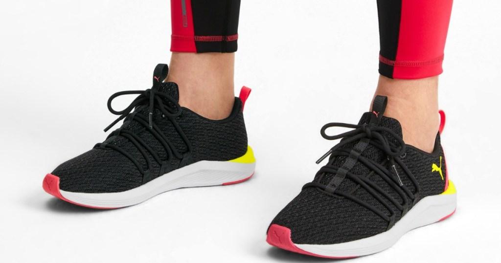 woman wearing PUMA Running Shoes