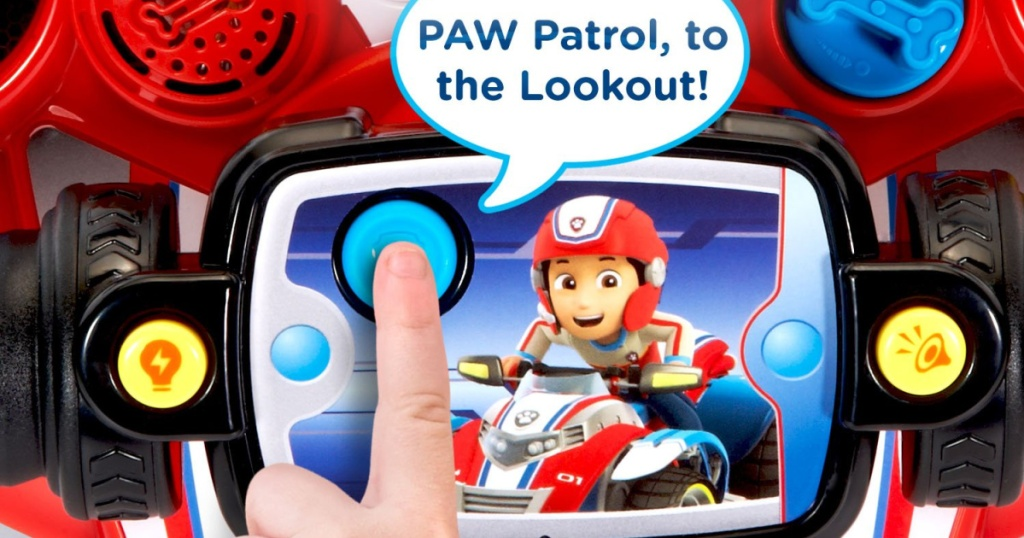 hand playing iwth paw patrol vtech toy