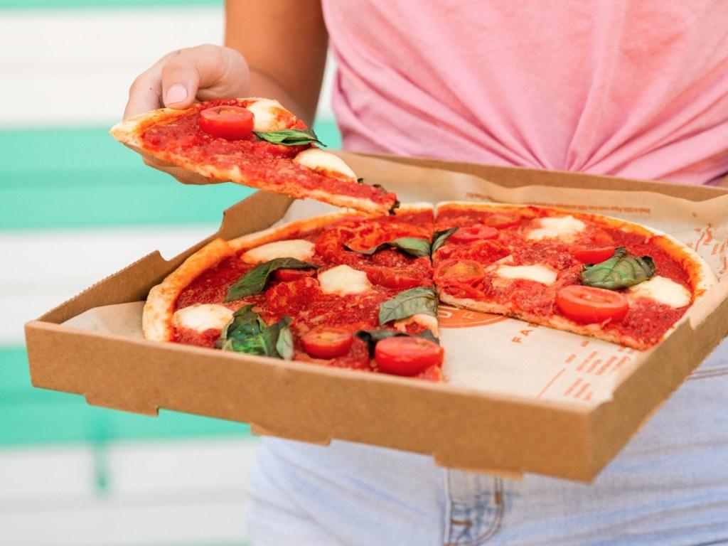 Person Holding Blaze Pizza Box