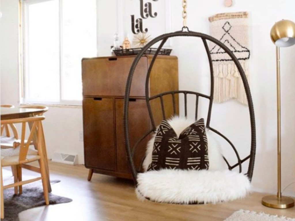 Pier 1 Chair Swing in a living room with a pillow