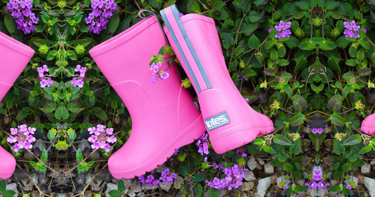 Pink Totes Cirrus Charley Kids Rain Boots in field of flowers