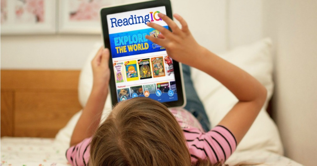 Girl on bed using ReadingIQ on her iPad