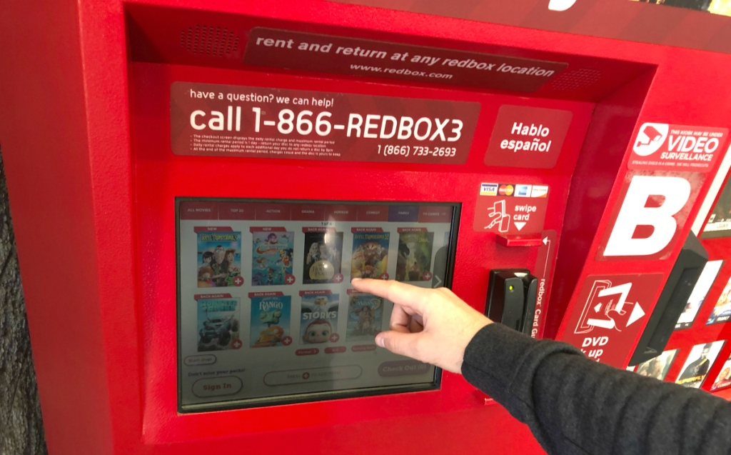 hand touching Redbox screen