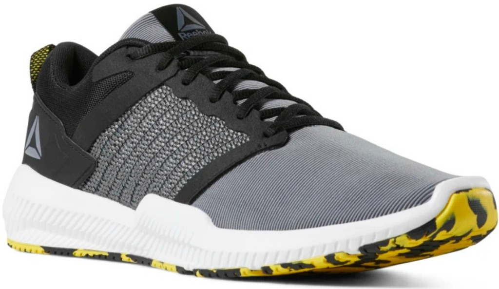 Men's Reebok brand training shoes with yellow and black swirled sole