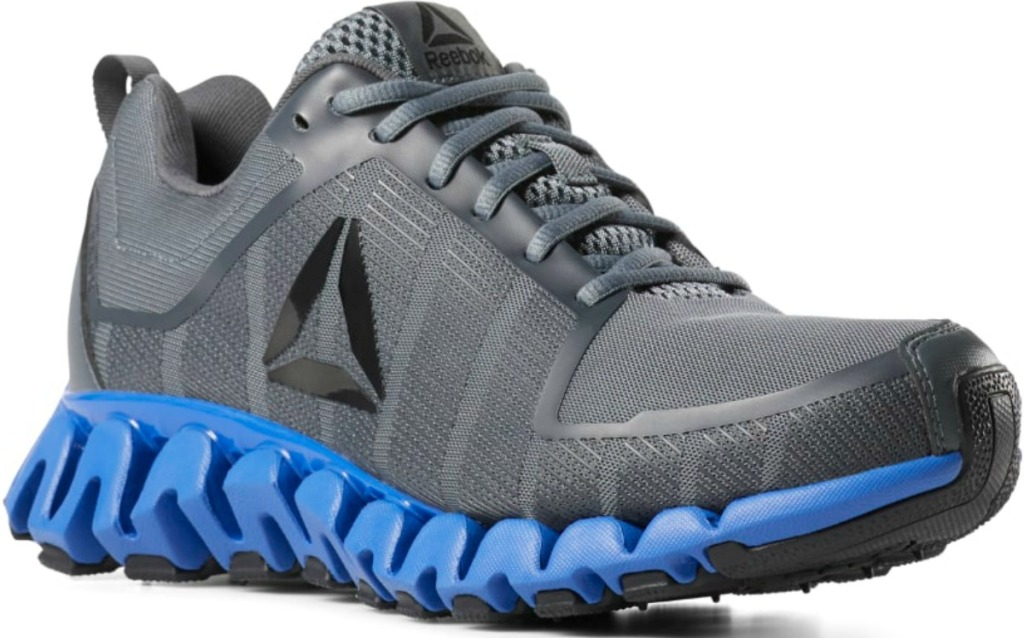 Reebok Men's Shoes in dark gray with blue soles
