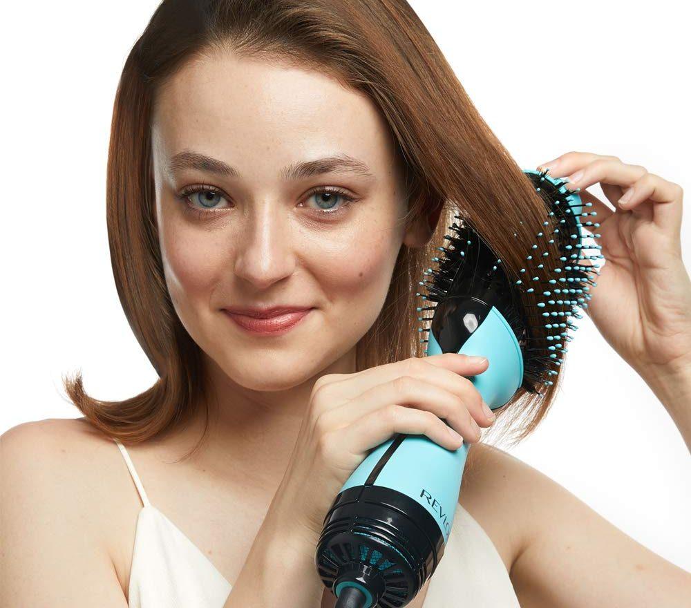 person using their Revlon Hair Dryer on hair