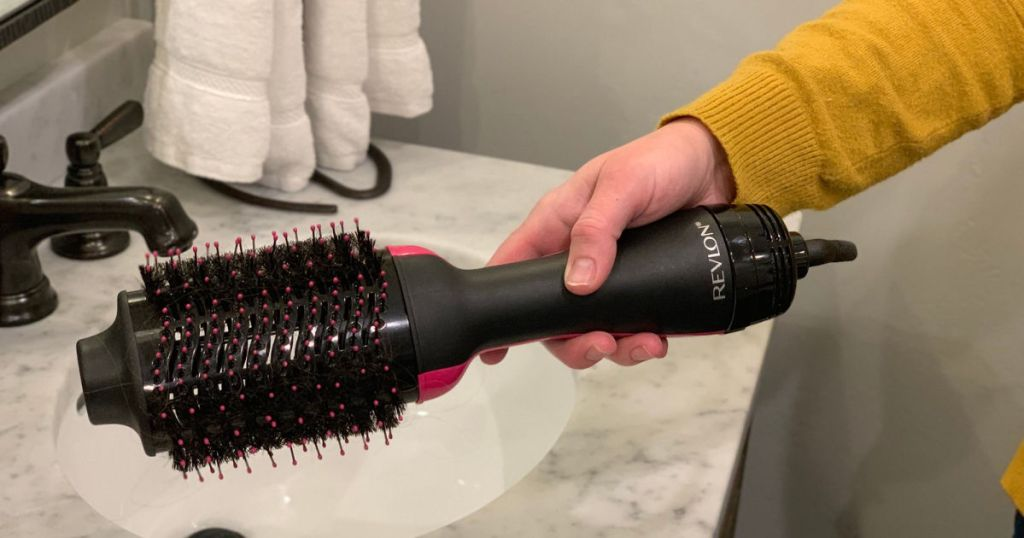 Revlon Hair Dryer And Volumizer being held in hand