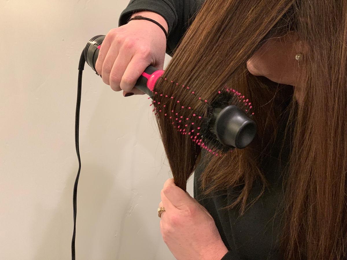 woman using Revlon Hair Dryer And Volumizer in bathroom