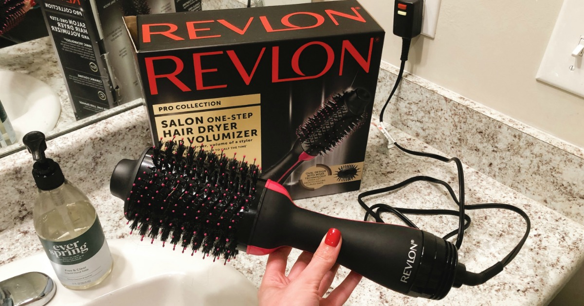 hand holding Revlon Hair Dryer in bathroom with box in the background