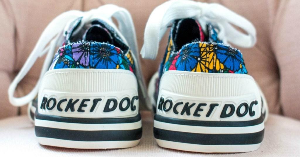 Floral print RocketDog Sneakers on sofa