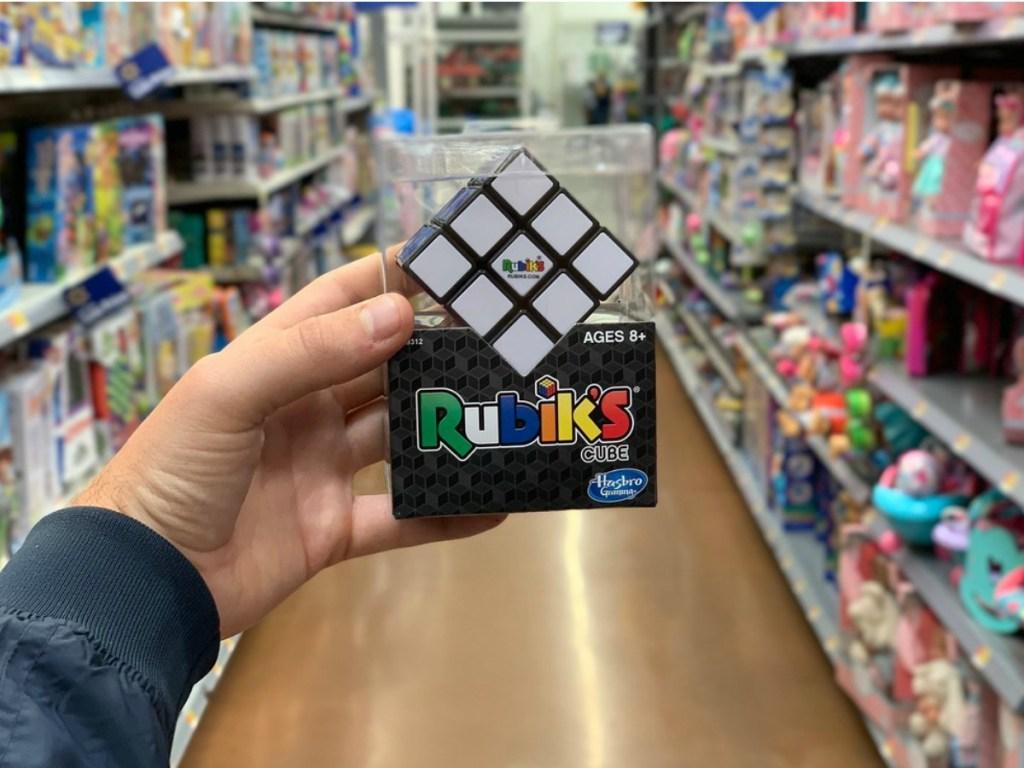 man holding a Rubik's cube at Walmart