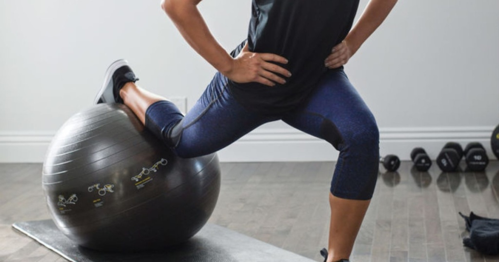 woman exercising on SKLZ workout ball