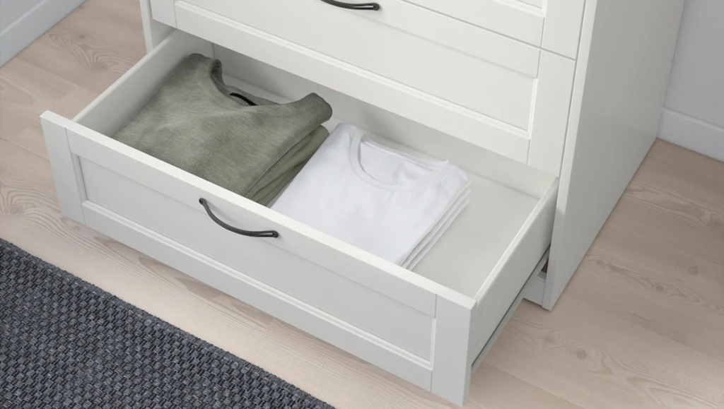 green and white shirts in bottom drawer of dresser IKEA