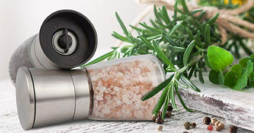 stainless steel grinder set with herbs