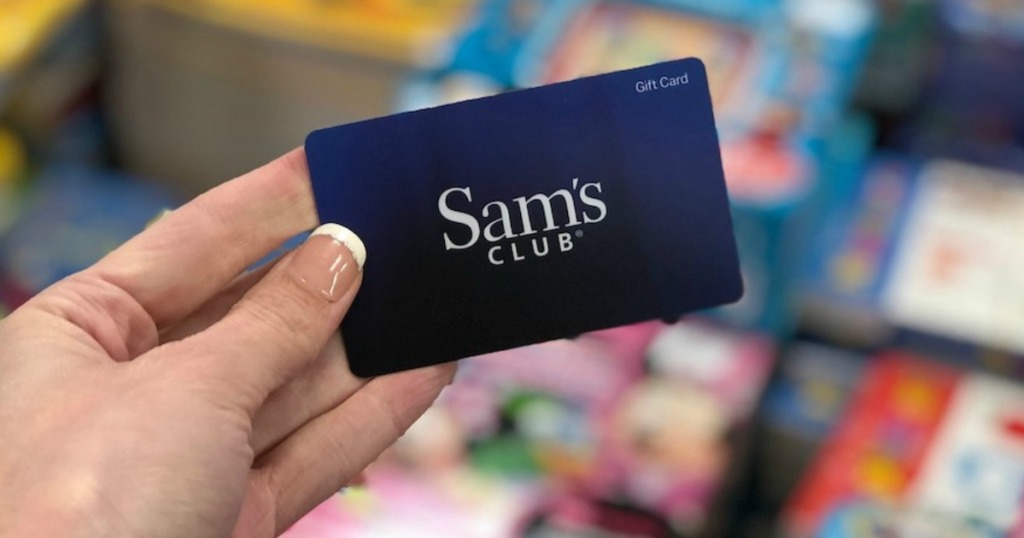 Sam's Club Gift Card being held by a woman's hand