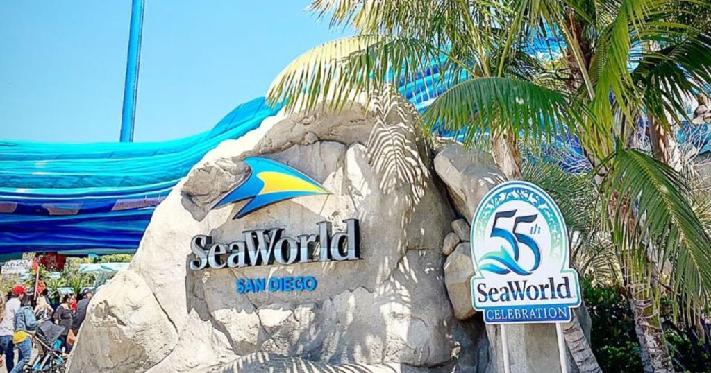 Sea World San Diego front with rocks and palm trees