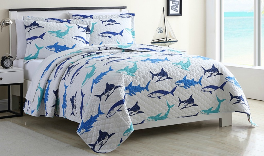 Shark print kids quilt from Zulily on full size bed