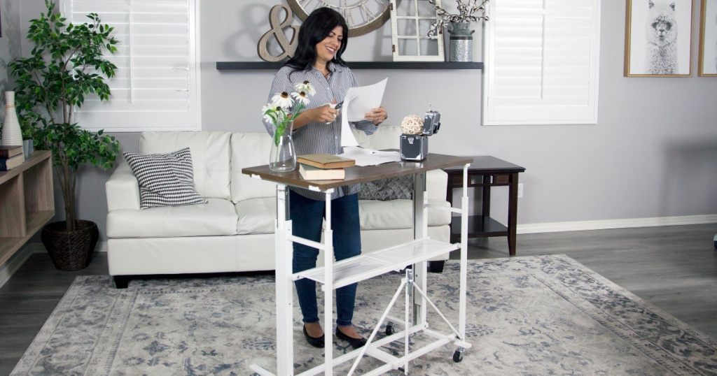 woman using white sit stand desk