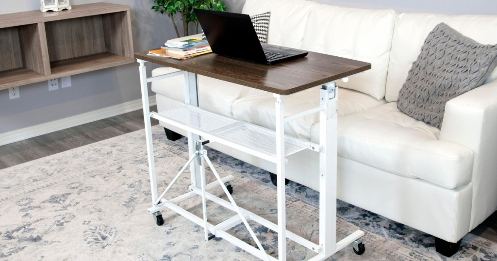 white sit stand adjustable desk and work station in living room