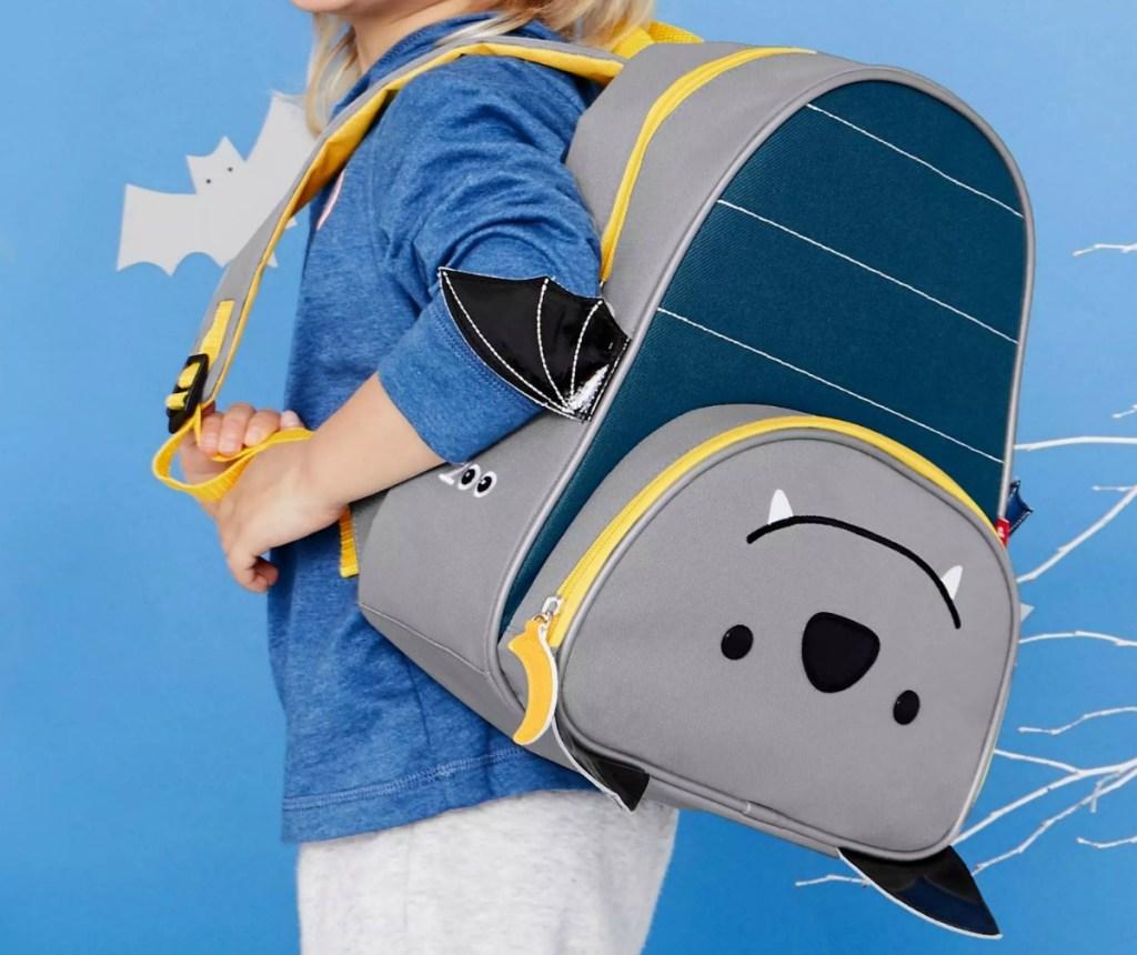 Boy wearing a Skip Hop brand backpack
