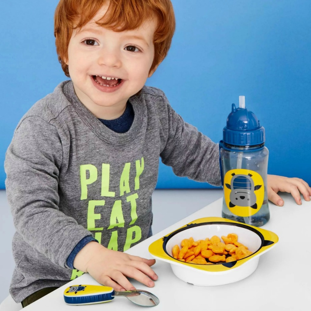 Boy at table with Skip Hop bat themed dinnerware